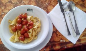A wonderful and simple lunch - taglietelle with rosemary, tomatoes, and formaggio.